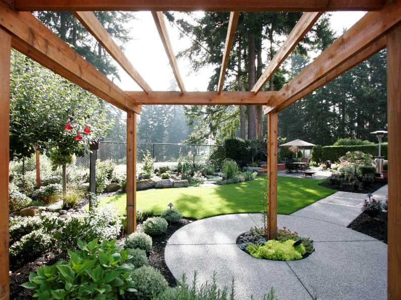 Olympic Landscape can build you a breathtaking entrance to your garden area with a custom built wood arbor or pergola.