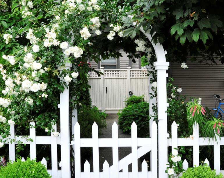Looking for great garden accent ideas? Elegant wood arbors and fences provide a welcoming entrance to your outdoor space.