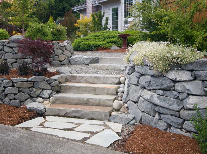 Curb appeal can be added to your home with natural stone steps and walkways.