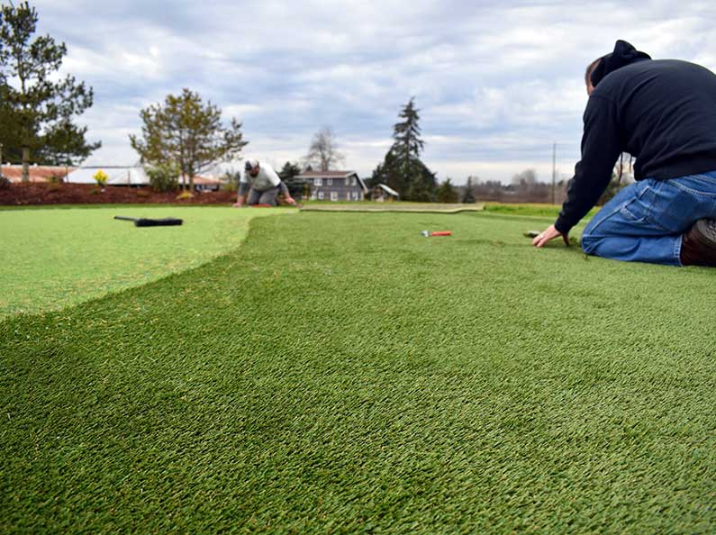 Tired of mowing the yard? Artificial grass is low maintenance and saves on the water bill!