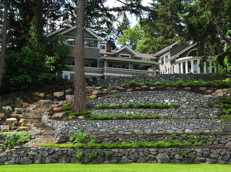 Add visual impact to your property with sound built, and beautifully designed natural stone walls and steps.