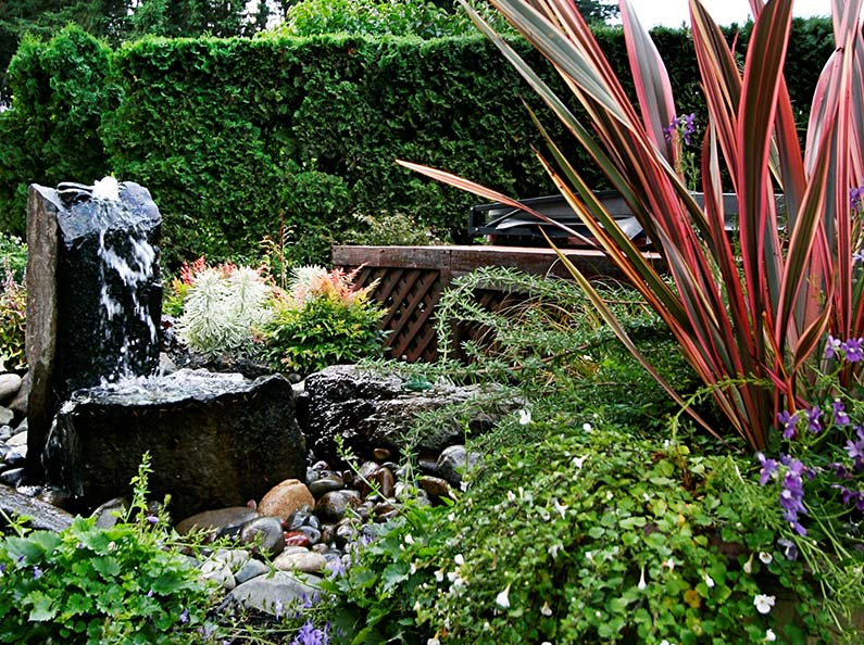 A bubbling water fountain can add serenity. Olympic's Landscapes can help you from design to installation with their expertise in water feature construction.
