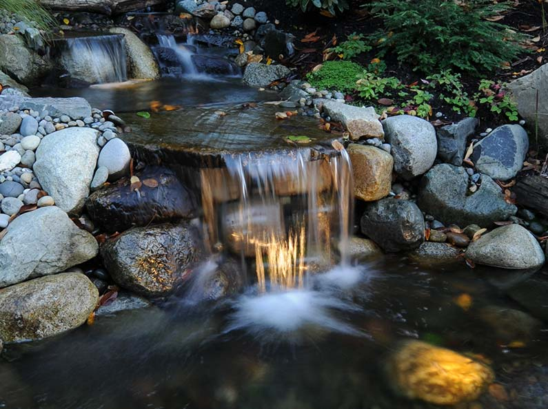 Waterfalls, ponds, fountains... What water feature accent do you envision for your outdoor space?